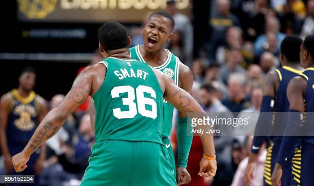 Terry Rozier of the Boston Celtics celebrates with Marcus Smart after the 112111 victory over the Indiana Pacers at Bankers Life Fieldhouse on...
