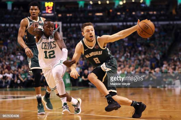 Terry Rozier of the Boston Celtics defends Matthew Dellavedova of the Milwaukee Bucks during the first quarter of Game Seven in Round One of the 2018...