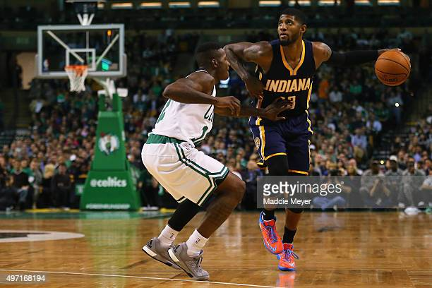 Terry Rozier of the Boston Celtics defends Paul George of the Indiana Pacers at TD Garden on November 11 2015 in Boston Massachusetts NOTE TO USER...
