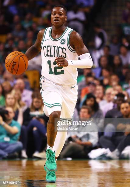 Terry Rozier of the Boston Celtics dribbles against the Charlotte Hornets during the second half at TD Garden on October 2 2017 in Boston...