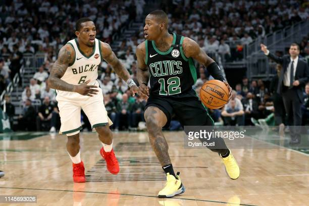 Terry Rozier of the Boston Celtics dribbles the ball while being guarded by Eric Bledsoe of the Milwaukee Bucks in the second quarter during Game One...