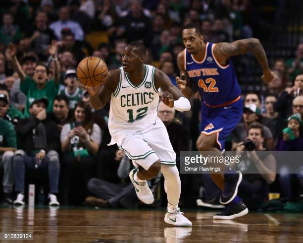 Terry Rozier of the Boston Celtics dribbles up the court during the fourth quarter of the game against the New York Knicks at TD Garden on January 31...