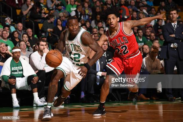 Terry Rozier of the Boston Celtics drives to the basket against Cameron Payne of the Chicago Bulls during the game on March 12 2017 at the TD Garden...