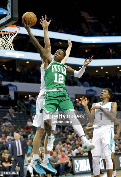Terry Rozier of the Boston Celtics drives to the basket against the Charlotte Hornets during their game at Spectrum Center on October 11 2017 in...