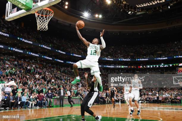 Terry Rozier of the Boston Celtics drives to the basket against the San Antonio Spurs on October 30 2017 at the TD Garden in Boston Massachusetts...