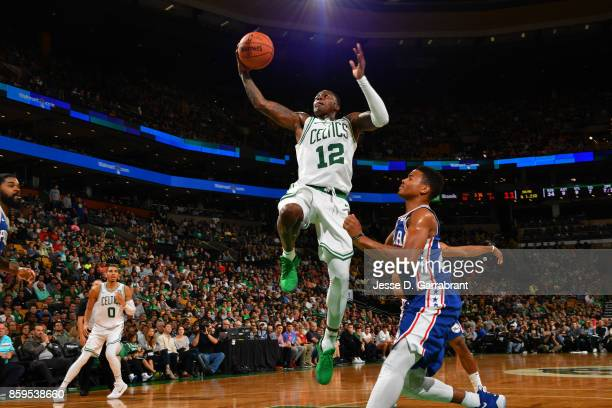 Terry Rozier of the Boston Celtics goes to the basket against the Philadelphia 76ers during a preseason game on October 9 2017 at TD Garden in Boston...