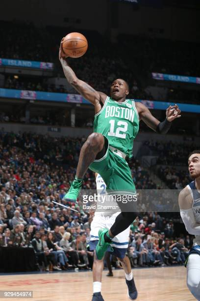 Terry Rozier of the Boston Celtics goes to the basket against the Minnesota Timberwolves on March 8 2018 at Target Center in Minneapolis Minnesota...