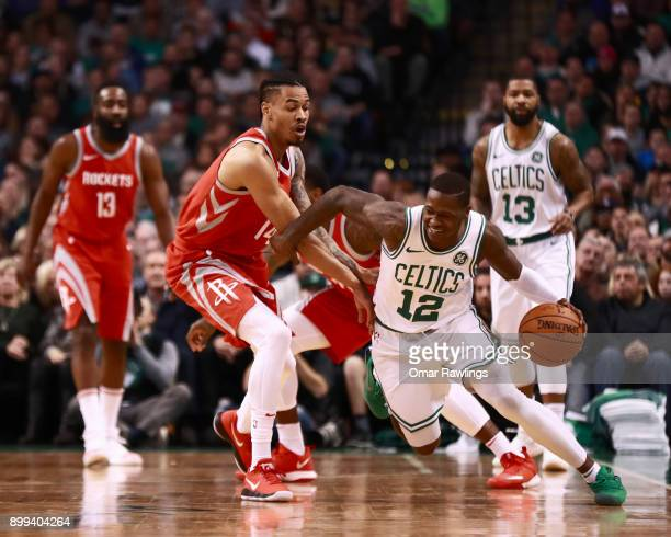Terry Rozier of the Boston Celtics handles the ball against Gerald Green of the Houston Rockets during the first quarter of the game at TD Garden on...