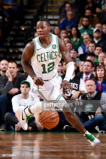 Terry Rozier of the Boston Celtics handles the ball during the game against the Dallas Mavericks on December 6 2017 at the TD Garden in Boston...