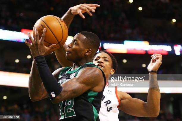 Terry Rozier of the Boston Celtics is fouled by DeMar DeRozan of the Toronto Raptors during a game at TD Garden on March 31 2018 in Boston...