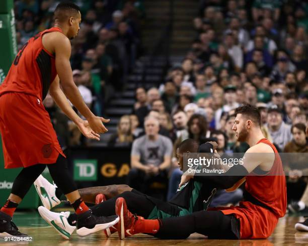 Terry Rozier of the Boston Celtics is fouled by Jusuf Nurkic of the Portland Trail Blazers during the fourth quarter of the game at TD Garden on...
