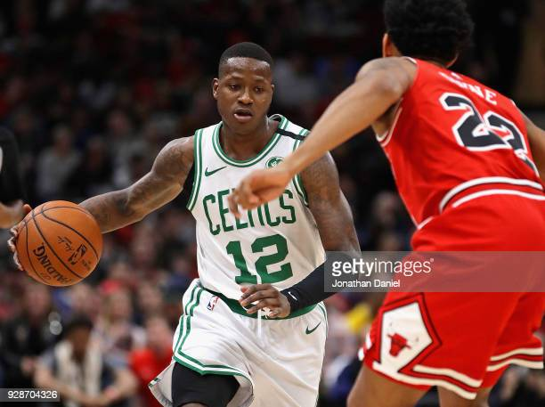 Terry Rozier of the Boston Celtics moves against Cameron Payne of the Chicago Bulls at the United Center on March 5 2018 in Chicago Illinois The...