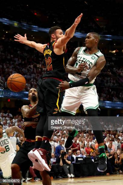 Terry Rozier of the Boston Celtics passes around Larry Nance Jr of the Cleveland Cavaliers in the fourth quarter during Game Six of the 2018 NBA...