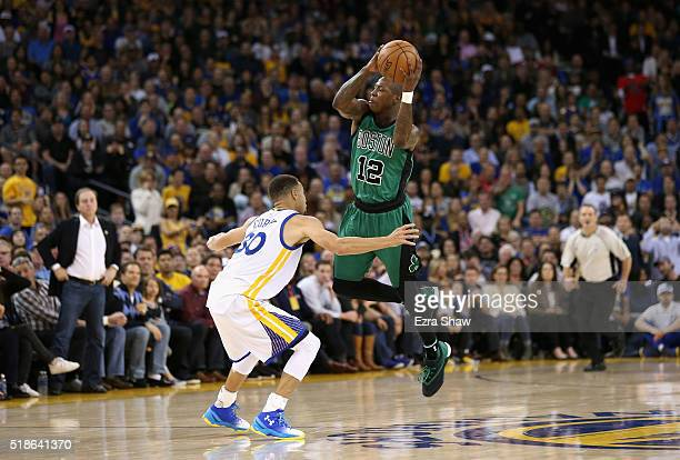 Terry Rozier of the Boston Celtics passes over Stephen Curry of the Golden State Warriors at ORACLE Arena on April 1 2016 in Oakland California NOTE...