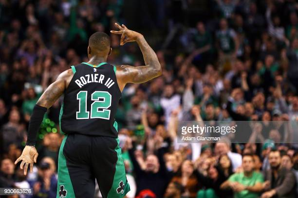Terry Rozier of the Boston Celtics reacts after hitting a threepoint shot during a game against the Indiana Pacers at TD Garden on March 11 2018 in...