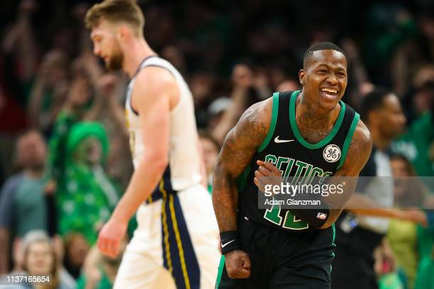 Terry Rozier of the Boston Celtics reacts after making a shot as time expires in ethics's third quarter during Game One of the first round of the...