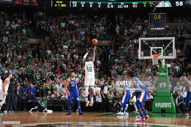 Terry Rozier of the Boston Celtics shoots a buzzer beater to end the first half against the Philadelphia 76ers in Game Five of the Eastern Conference...