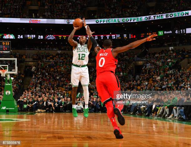Terry Rozier of the Boston Celtics shoots the ball during the game against the Toronto Raptors on November 12 2017 at the TD Garden in Boston...
