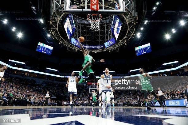 Terry Rozier of the Boston Celtics shoots the ball during the game against the Minnesota Timberwolves on March 8 2018 at Target Center in Minneapolis...