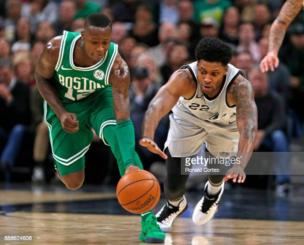 Terry Rozier of the Boston Celtics steals the ball from Rudy Gay of the San Antonio Spurs at ATT Center on December 08 2017 in San Antonio Texas NOTE...