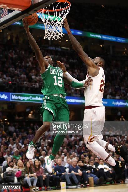 Terry Rozier of the Boston Celtics tries to get a shot off past LeBron James of the Cleveland Cavaliers during the second half at Quicken Loans Arena...