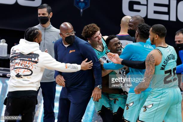 Terry Rozier of the Charlotte Hornets celebrates with his team after hitting the game-winning three point basket during the final seconds of the...