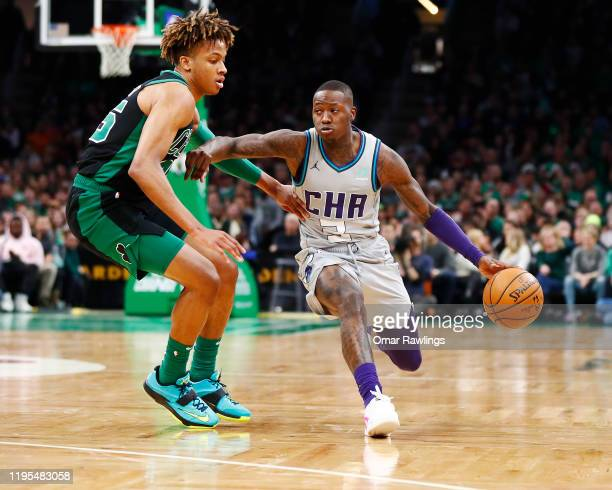 Terry Rozier of the Charlotte Hornets drives to the basket on Romeo Langford of the Boston Celtics during the second quarter of the game at TD Garden...