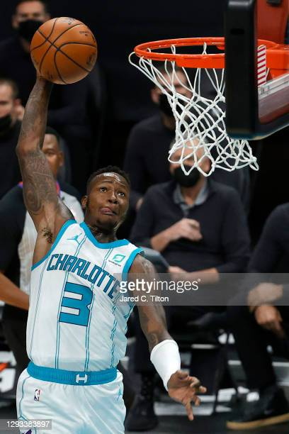 Terry Rozier of the Charlotte Hornets dunks the ball against Kevin Durant of the Brooklyn Nets during the third quarter of their game at Spectrum...