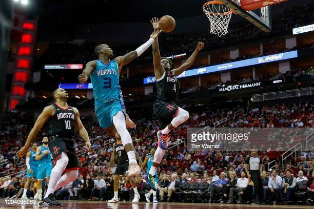 Terry Rozier of the Charlotte Hornets shoots the ball while defended by Danuel House Jr #4 of the Houston Rockets in the second half at Toyota Center...