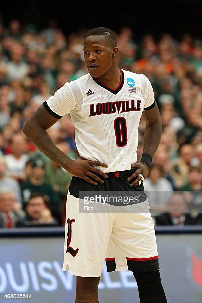 Terry Rozier of the Louisville Cardinals looks on in the second half of the game against the Michigan State Spartans during the East Regional Final...