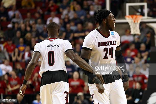 Terry Rozier of the Louisville Cardinals reacts with teammate Montrezl Harrell in the second half of the game against the Northern Iowa Panthers...