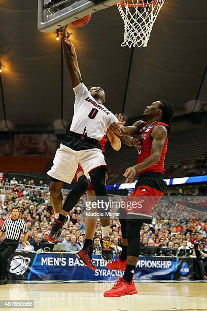 Terry Rozier of the Louisville Cardinals shoots the ball over Anthony Barber of the North Carolina State Wolfpack during the East Regional Semifinal...