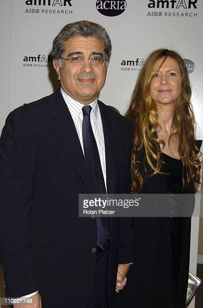 Terry Semel and guest during amfAR and ACRIA Honor Herb Ritts with a Sale of Contemporary Artwork Arrivals at Sothebys in New York New York United...