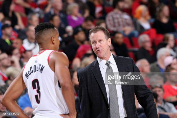 Terry Stotts and CJ McCollum of the Portland Trail Blazers talk during the game against the Phoenix Suns on October 3 2017 at the Moda Center in...