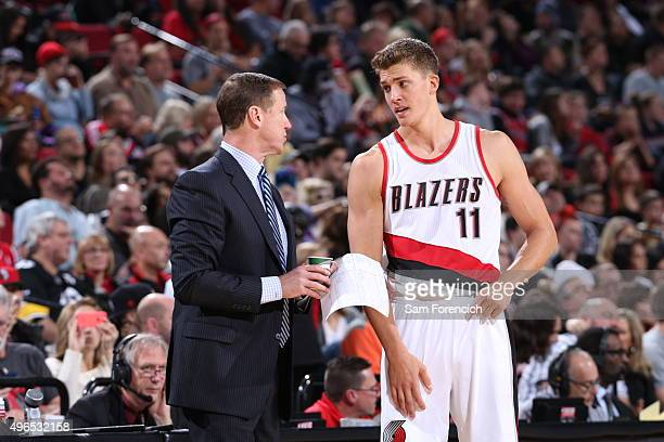 Terry Stotts and Meyers Leonard of the Portland Trail Blazers talk during the game against the Phoenix Suns on October 31 2015 at the Moda Center in...