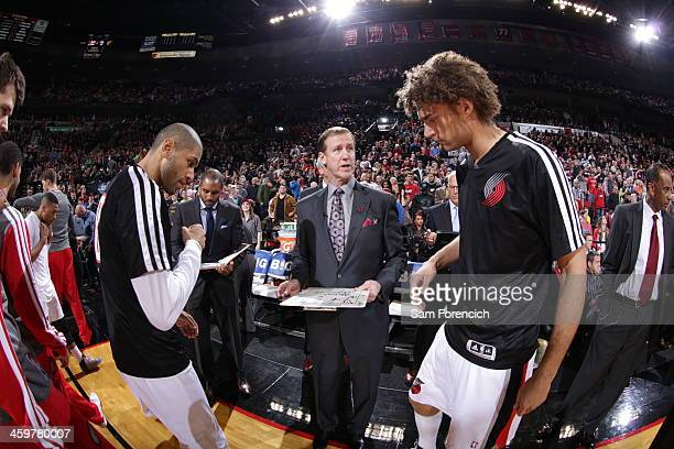 Terry Stotts of the Portland Trail Blazers stands on the court before the game against the Los Angeles Clippers on December 26 2013 at the Moda...