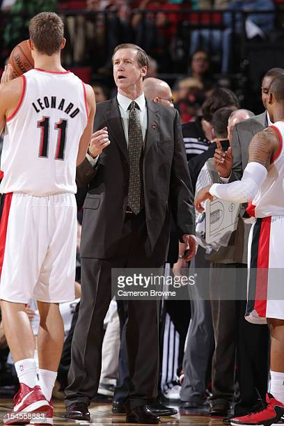 Terry Stotts of the Portland Trail Blazers talks with Meyers Leonard during the game against the Golden State Warriors on October 19 2012 at the Rose...
