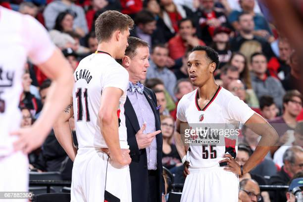 Terry Stotts of the Portland Trail Blazers talks with Meyers Leonard and Tim Quarterman of the Portland Trail Blazers on April 12 2017 at the Moda...