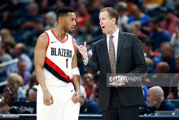 Terry Stotts the head coach of the Portland Trailblazers talks with Evan Turner during the game against the Indiana Pacers at Bankers Life Fieldhouse...