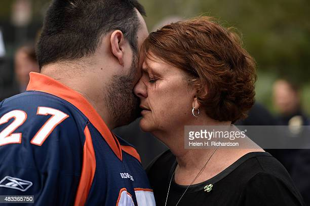 Terry Sullivan right mother of Aurora theater shooting victim Alex Sullivan hugs Bryan Beard left Alex's best friend outside of the Arapahoe County...