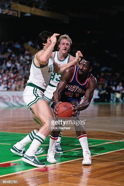 Terry Tyler of the Detroit Pistons looks to make a move against Scott Wedman and Larry Bird of the Boston Celtics during a game played in 1984 at the...
