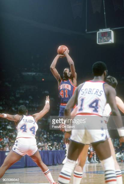 Terry Tyler of the Detroit Pistons shoots over Rick Mahorn of the Washington Bullets during an NBA basketball game circa 1982 at the Capital Centre...