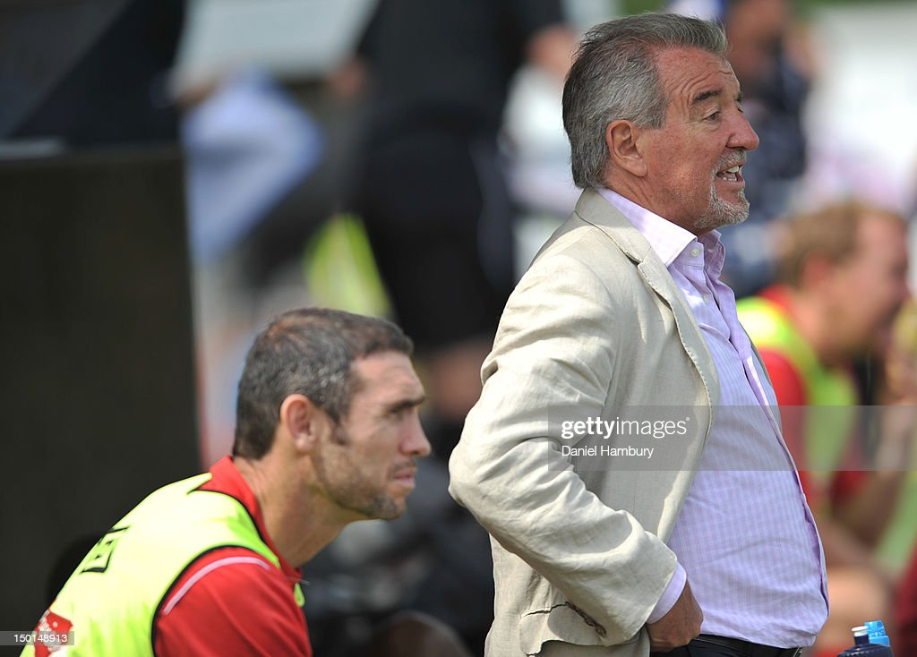 Terry Venables, technical advisor, and Martin Keown of Wembley FC look on during a Budweiser FA Cup Extra Preliminary Round at Vale Farm Stadium, on August 11, 2012 in Wembley, London, England.