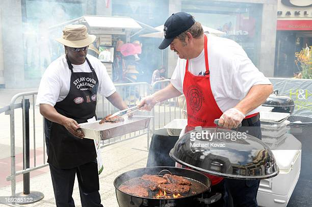 Terry Vick of the Houston Fire Department Honor Guard grills Walmart USDA Choice steaks during the Walmart SteakOver Challenge national competition...