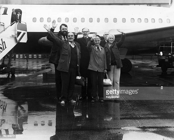 Terry Waite with the British church workers held hostage in the Lebanon, at Heathrow airport.