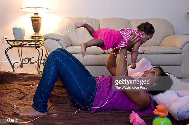 Terry Ware and her 14monthold daughter Micah WareBrody pose for a photo at their home in Greenbelt MD on June 28 2011 Ware was able to stay in her...