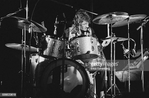 Terry Williams of Man performing on stage at Hammersmith Odeon London May 1976