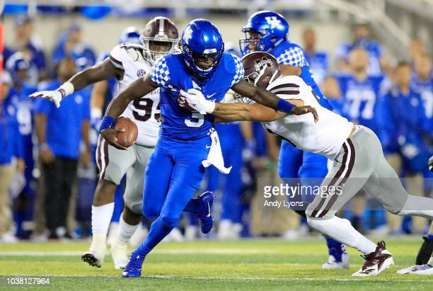 Terry Wilson of the Kentucky Wildcats is sacked by Montez Sweat of the Mississippi State Bulldogs at Commonwealth Stadium on September 22 2018 in...