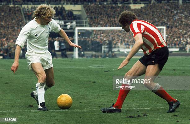Terry Yorath of Leeds United looks to take the ball past Vic Halom of Sunderland during the FA Cup Final held on May 5 1973 at Wembley Stadium in...