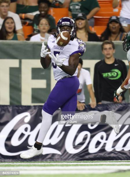 Terryon Robinson of the Western Carolina Catamounts makes a catch in the end zone to score a touchdown in the second quarter of the game against the...